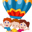Happy kids riding a hot air balloon — Imagen vectorial