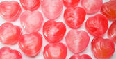 Heart shaped candy as background — Stock Photo
