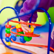 Children playing bead roller coaster — Stock Photo