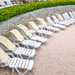 Stock Photo: Untidy beach chairs to be cleaned up