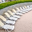 Untidy beach chairs to be cleaned up — Stock Photo