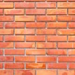 Brick wall in orange and yellow color — Stock Photo