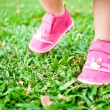 Stock Photo: Baby steps on grass