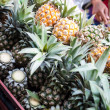 Pineapple in pushcart selling on street — Stock Photo
