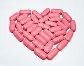 Heart shaped pill — Stock Photo