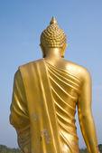 Walking buddha at the back — Stockfoto