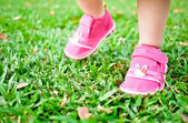 Baby steps on grass — Stock Photo