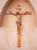Jesus cross isolated on stone wall — Stock Photo