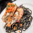 Black spaghetti with prawn — Stock Photo