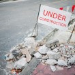 Under construction notice on the roadside — Stock Photo