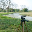 Tripod on natural scene — Stock Photo