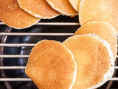 Pancakes isolated on grill — Stock Photo