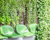 Plastic chairs among green garden — Stock Photo