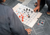 People playing Thai chess on the floor — Foto de Stock