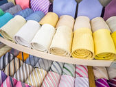 Many necktie rolls display — Stock Photo