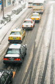 Taxis line during snow storm — Stock Photo