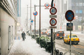 People walks during snow storm — Stock Photo