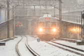 Train runs on track in snow storm — Foto de Stock