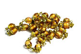 Golden and Brass Beads on Bracelet Chain — Stock Photo
