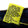 Washing Jeans Instructions — Stock Photo