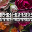 Stock Photo: Happy weekend with flowers