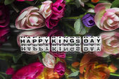 Happy kings day message with flowers — Stock Photo
