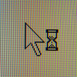 Hour glass and arrow cursor — Photo