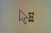 Hour glass and arrow cursor — Stock Photo