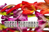 Happy birthday with pink and red flowers — Stock Photo