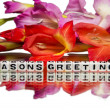 Stock Photo: Seasons greetings with flowers