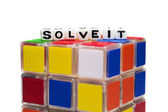 Solve it text on half cube — Stockfoto