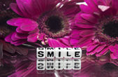 Pink flowers and smile text message — Stock Photo