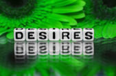 Desires text with green flowers — Stock Photo