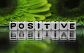 Positive text with green flowers — Stock Photo
