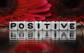 Positive text with red flowers — Stock Photo