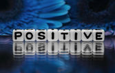 Positive text with blue flowers — Stock Photo