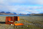 Iron boxes on the beach in Spitsbergen (Svalbard) — Stok fotoğraf