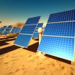 Sunny solar panels in a solar power station - Stock Photo