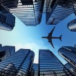 Business towers with a airplane silhouette — Stockfoto