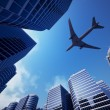 Stock Photo: business towers with a airplane silhouette