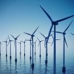 Floating wind turbines during hazy day. — Stock Photo