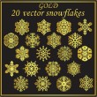 Set gold snowflakes on black background — Stock vektor