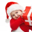 Girl smiling with gift box. — Stock Photo #34549497