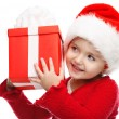 Girl smiling with gift box. — Stock Photo