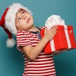 Funny child in Santa red — Stockfoto