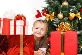 Girl smiling with gift box — Stock Photo