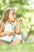 Little girl and soap bubbles — Stock Photo