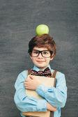 Little boy with apple on head — Stock Photo