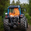 Tractor in the flames - Stock Photo