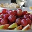Royalty-Free Stock Photo: A plate of grapes and apples.